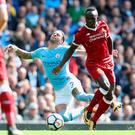 Blow: Sadio Mane could be out for up to six weeks after being injured on international duty