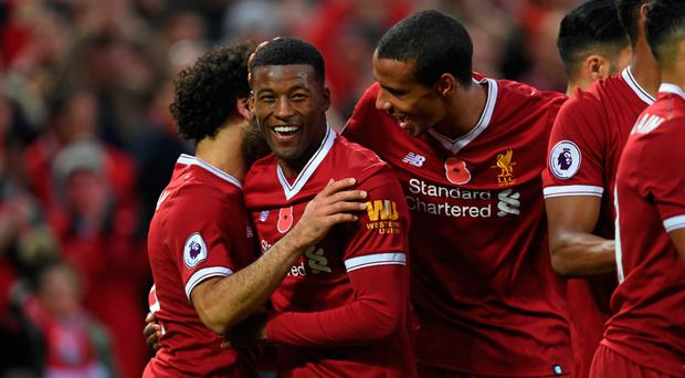 Centre of attention: Georginio Wijnaldum is congratulated after adding Liverpool's third