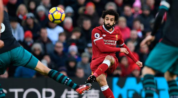 Top man: Jurgen Klopp and Jordan Henderson have both praised Mohamed Salah's performances
