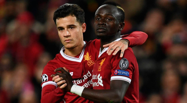 Goals galore: Sadio Mane (right) celebrates scoring his second and Liverpool's fifth with hat-trick hero Philippe Coutinho
