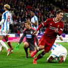 Firm favourite: Liverpool's Roberto Firmino celebrates scoring his side's second goal