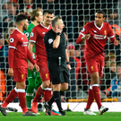 Liverpool players remonstrate with referee Jonathan Moss following Spurs' second penalty award