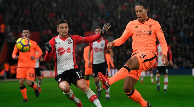 Easy does it: Liverpool defender Virgil van Dijk keeps his cool under pressure from Dusan Tadic