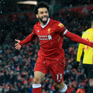 To the four: Mohamed Salah celebrates after running the Watford defence ragged