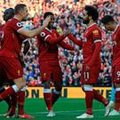 Mo Salah is congratulated after making it 2-0