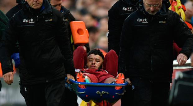 Injury woe: Alex Oxlade-Chamberlain was carried off on Tuesday