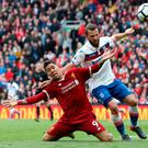 Muscled out: Roberto Firmino battles with Stoke's Erik Pieters