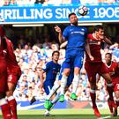 Moving up: Olivier Giroud heads Chelsea in front