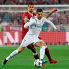 Close eye: Dejan Lovren aims to pressure Cristiano Ronaldo