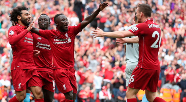 Red wave: Mo Salah opened the scoring for Liverpool as new look West Ham were beaten 4-0