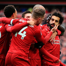 Top drawer: Liverpool forward Mohamed Salah is mobbed by team-mates after his wonder strike