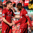 Cruel end: James Milner consoles his team-mate Georginio Wijnaldum