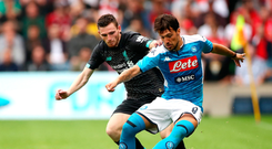 Man on: Simone Verdi of Napoli is challenged by Andy Robertson