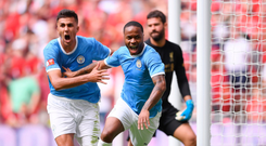 Wembley way: Manchester City's Raheem Sterling (centre) turns away after scoring