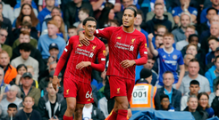 On course: Trent Alexander-Arnold is congratulated by Virgil van Dijk after Liverpool opener