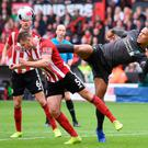 Foot work: Liverpool defender Virgil van Dijk stretches out a leg as Jack O'Connell heads clear