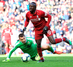 Mane man: Sadio Mane puts the seal on Liverpool's win after skipping past Clarets keeper Tom Heaton