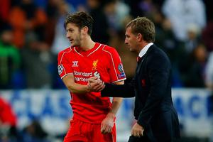 Shake on it: Brendan Rodgers acknowledges Adam Lallana at the Bernabeu, one of several key changes to his starting line-up