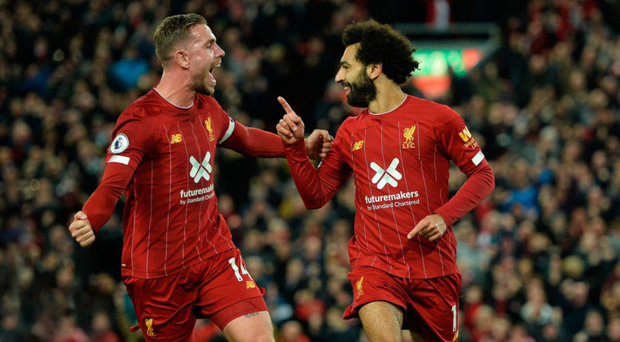 In control: Jordan Henderson salutes fellow scorer Mohamed Salah as Liverpool take the lead