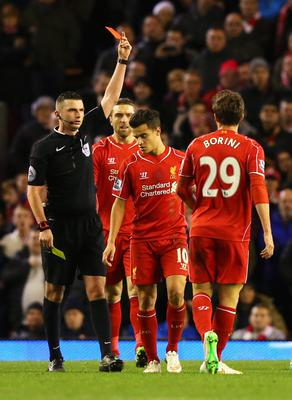 Away you go: Fabio Borini is shown the red card by referee Michael Oliver