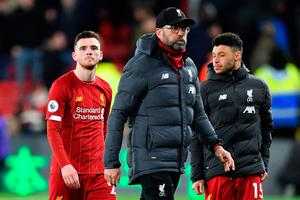 Bad night: Jurgen Klopp and his players trudge off after a rare Premier League defeat