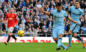 Star man: Sergio Aguero strikes to score the decisive goal at the Etihad to give City a vital win in the title race