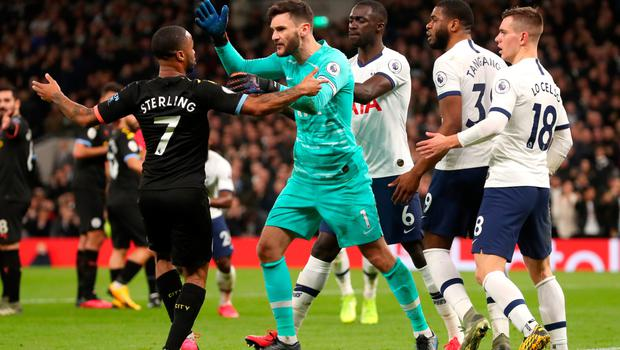 Boiling point: Tempers flare as Hugo Lloris accuses Raheem Sterling of diving to try and win a second penalty for City