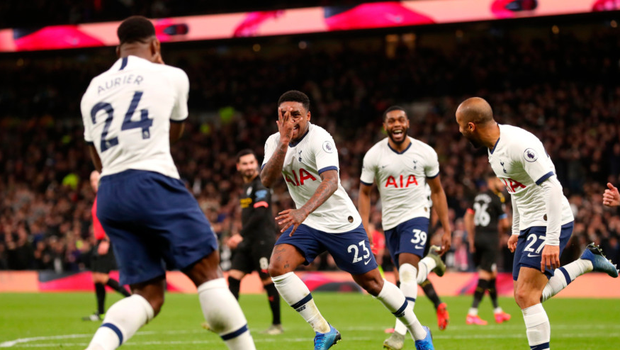 Right at home: Steven Bergwijn wheels away after his debut goal for Spurs