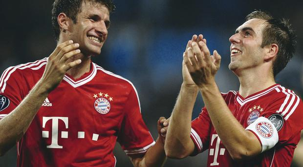 Top class: Thomas Muller and Philipp Lahm enjoy Bayern Munich's easy win over Manchester City at the Etihad