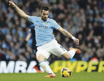 Alvaro Negredo of Manchester City shoots to score his team's fifth goal during the Barclays Premier League match against Tottenham Hotspur