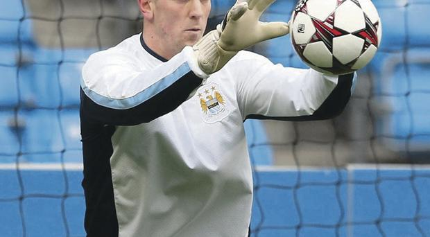Joe Hart makes a save in training ahead of his return to the Manchester City team against Plzen this evening