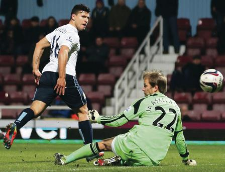 It's there: Manchester City striker Sergio Aguero chips the ball over West Ham goalkeeper Jussi Jaaskelainen in their win at Upton Park