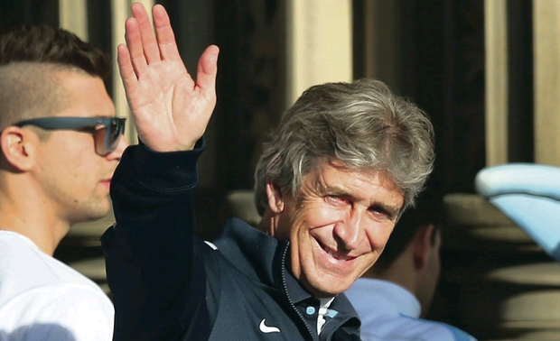 Aiming high: Manuel Pellegrini believes City have work to do in order to challenge for four pieces of silverware next campaign