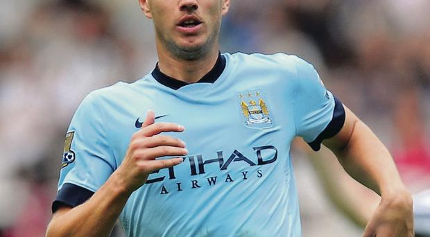 Deal him in: Edin Dzeko is rumoured to be close to extending his stay at the Etihad with a new contract in the offing