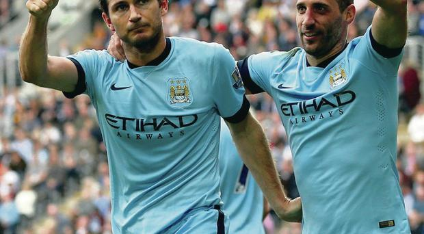 Blues brothers: Frank Lampard of Manchester City celebrates with team-mate Pablo Zabaleta