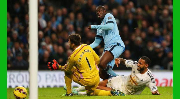 Back to his best: Yaya Toure powers through to score the winner against Swansea but he is suspended for the visit of Bayern