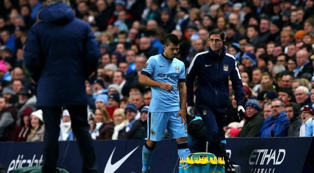 It all ends in tears: An emotional Sergio Aguero limps off after injuring his knee against Everton