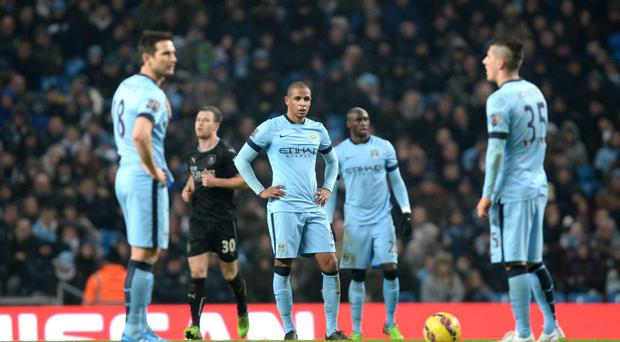 Got the blues: City stars stand dejected at the afternoon's work