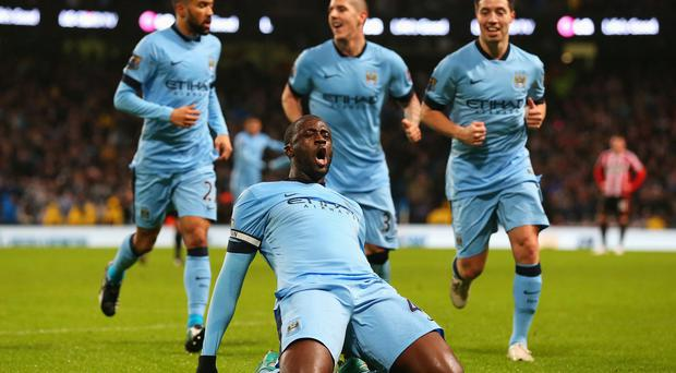 Missing link: Yaya Toure will be unavailable for Manchester City for up to four weeks due to the African Nations Cup