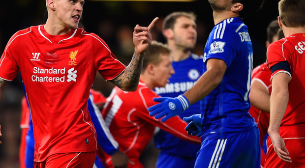 Martin Skrtel of Liverpool clashes with Chelsea's Diego Costa