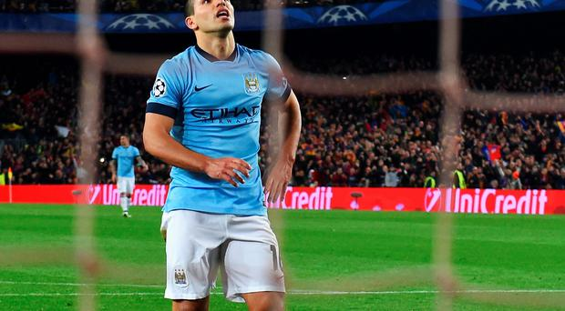 Missed opportunity: Sergio Aguero looks downbeat after his missed penalty against Barcelona as City's failings were cruelly exposed
