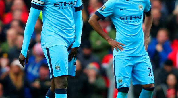 Where did it all go wrong: Manchester City duo Yaya Toure (left) and Fernandinho feel the strain during the derby day defeat