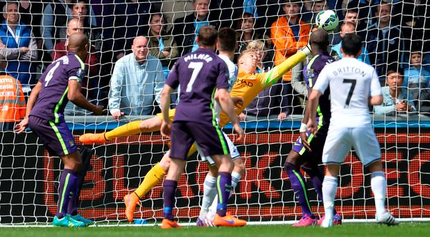 Safe hands: Joe Hart helped keep Man City's push for second on track with a number of crucial saves