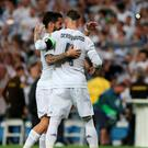 Real Madrid midfielder Isco (left) and defender Sergio Ramo celebrate