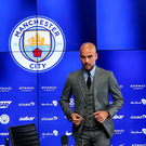 New surroundings: Manchester City boss Pep Guardiola meets the media at the Etihad