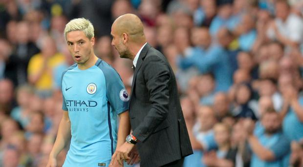 Advice: Man City manager Pep Guardiola talks to Samir Nasri
