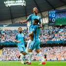 Lift off: Raheem Sterling celebrates with Nolito after scoring the opening goal at the Etihiad