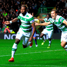 First strike: Moussa Dembele sets off in celebration after kicking off a manic night of goal action at Celtic Park