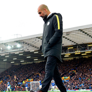 Unhappy man: Pep Guardiola on the touchnline at Goodison Park yesterday as his side shipped four goals to Everton