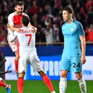 Painful: Dejected John Stones trudges off as the final whistle sparks Monaco celebrations